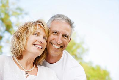 Couple hugging outside | CEREC dental crowns Eagan MN
