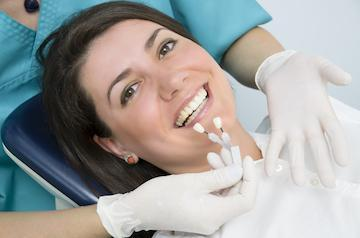 woman in dental chair getting veneers | Dentist Eagan MN