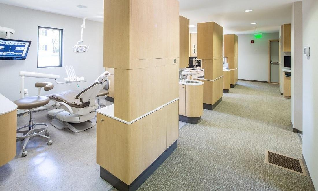 Row of patient treatment rooms at Wood Park Dental | 55122 Dentist Office